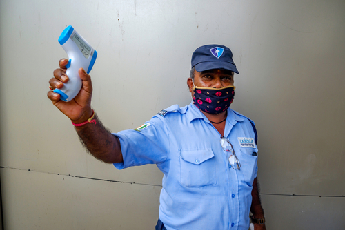 Masked security guard at an office complex